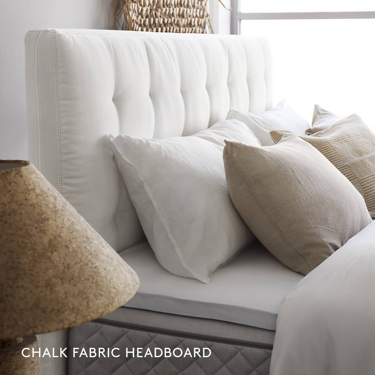Chalk Fabric Headboard with pillows over DUX bed