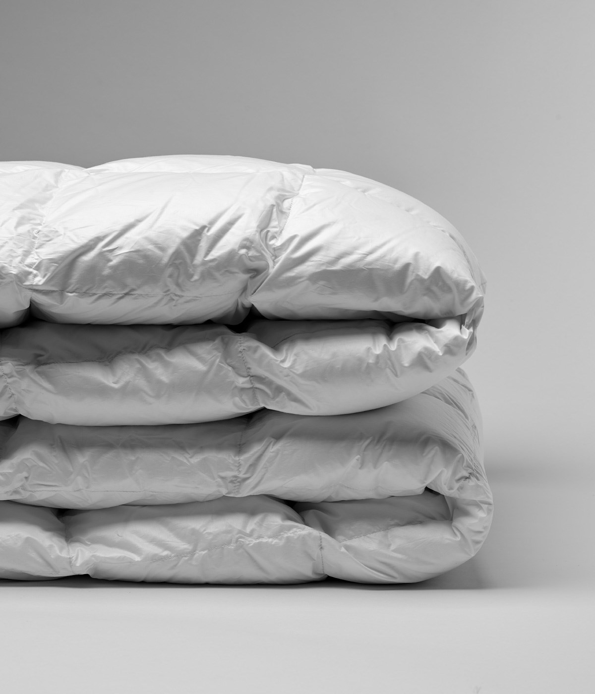 Down Comforters folded and stacked