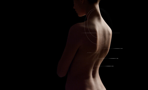 Video still of a woman's back - The Human Spine Is a Mechanical Marvel